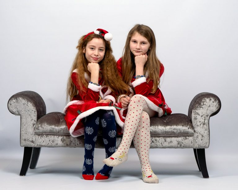 Posing in their red Father Christmas outfits